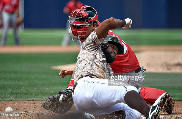 Abraham Almonte of the San Diego Padres scores as Jose Lobaton of the Washington Nationals loses the ball during the first inning of a baseball game...