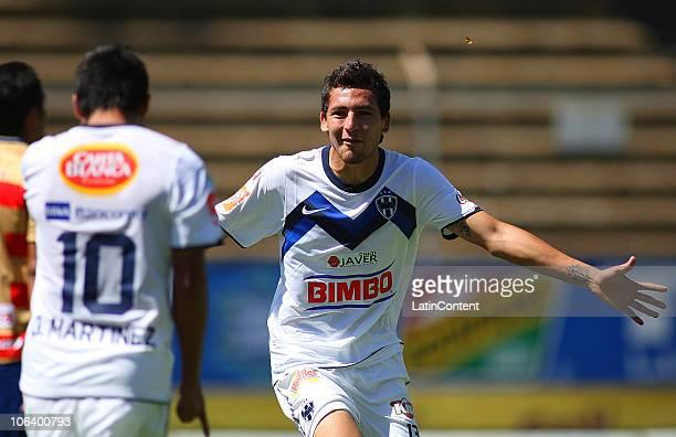 Abraham Dario Carreno of Monterrey celebrates his scored goal over Monarcas Morelia during their match as part of the Apertura 2010 at Morelos...