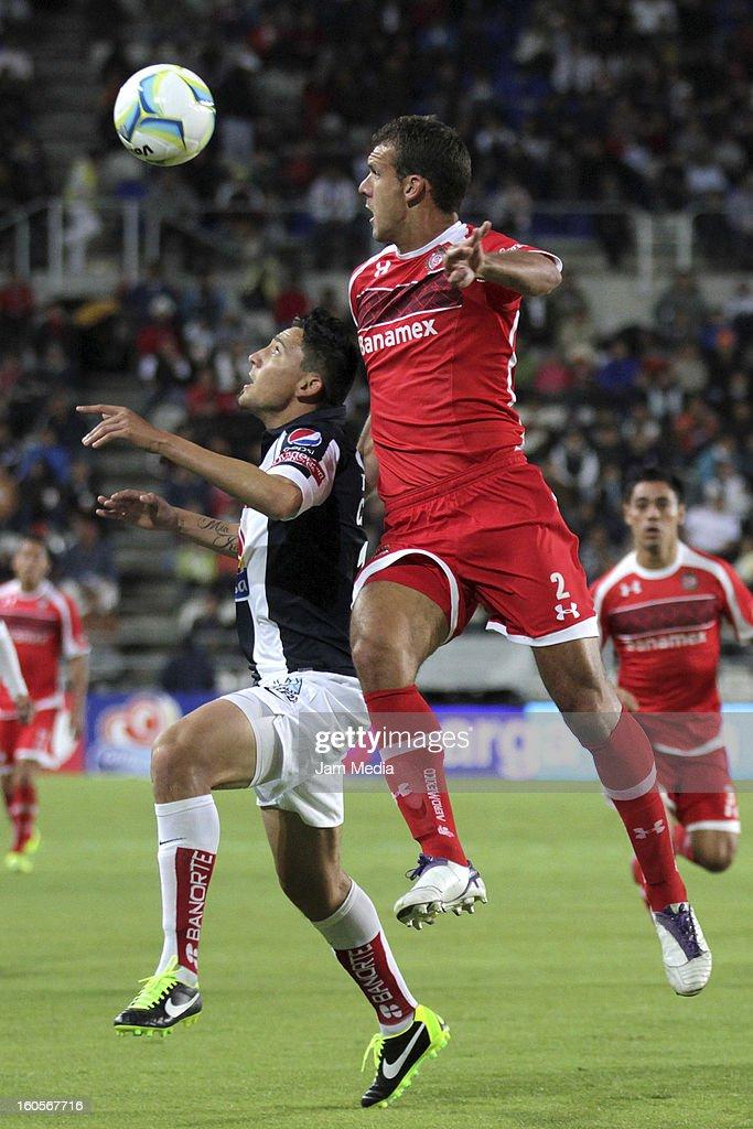 Abraham Dario Carreno (L) of Pachuca struggles for the ball with Diego Novaretti (R) of Toluca during the Clausura 2013 Liga MX at Hidalgo Stadium on february 2, 2013 in Pachuca, Mexico.