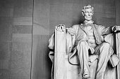 Imposing president Lincoln looking over the district. Black and white photo with perspective