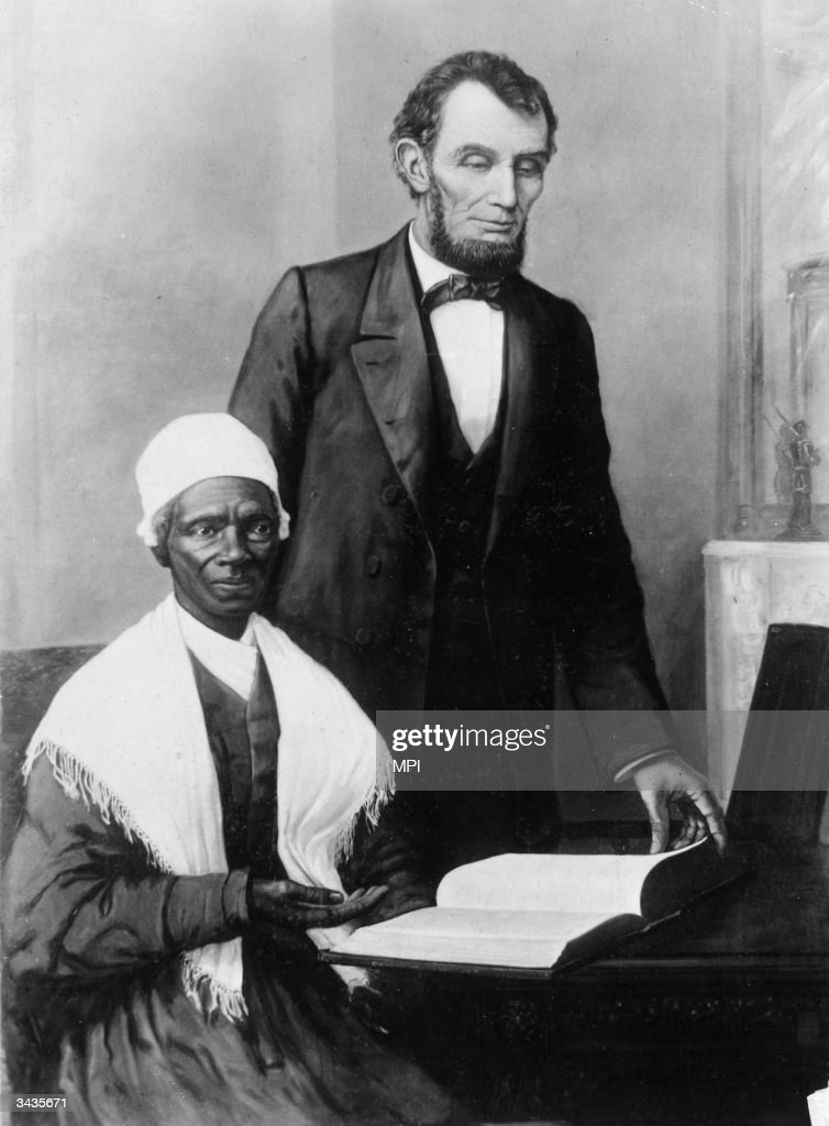 Abraham Lincoln (1809 - 1865) reading the Bible with former slave and abolitionist Sojourner Truth (1797-1883), originally Isabella Van Wagener, in a print presented to the President by the black community of Baltimore to commemorate the Emancipation Proclamation.