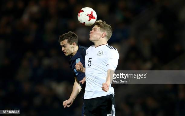 Abraham Tammy of England goes up for a header with Matthias Ginter of Germany during the U21 international friendly match between Germany and England...