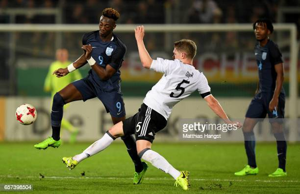 Abraham Tammy of England is challenged by Matthias Ginter of Germany during the U21 international friendly match between Germany and England at...