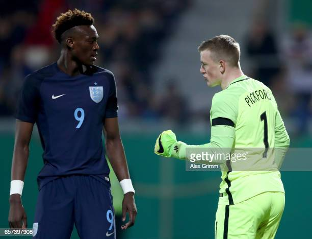 Abraham Tammy of England is seen with goalkeeper Jordan Pickford of England during the U21 international friendly match between Germany and England...