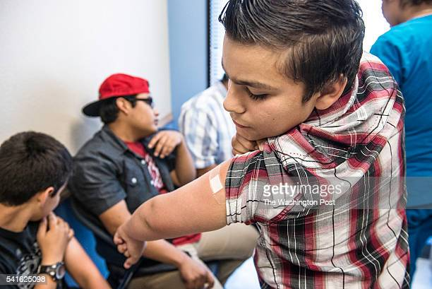 Abraham Vidaurre checks his arm after receiving an HPV vaccination at Amistad Community Health Center in Corpus Christi Texas on Friday May 27 2016...