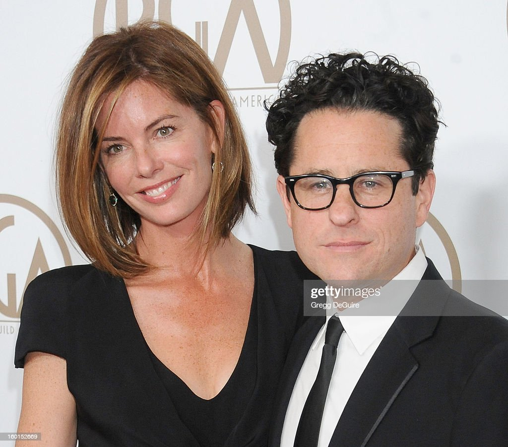 J.J. Abrams (R) and wife <a gi-track='captionPersonalityLinkClicked' href=/galleries/search?phrase=Katie+McGrath+-+Frau+von+J.J.+Abrams&family=editorial&specificpeople=15284071 ng-click='$event.stopPropagation()'>Katie McGrath</a> arrive at the 24th Annual Producers Guild Awards at The Beverly Hilton Hotel on January 26, 2013 in Beverly Hills, California.