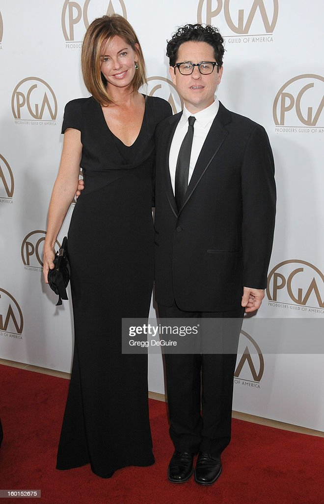 J.J. Abrams (R) and wife Katie McGrath arrive at the 24th Annual Producers Guild Awards at The Beverly Hilton Hotel on January 26, 2013 in Beverly Hills, California.