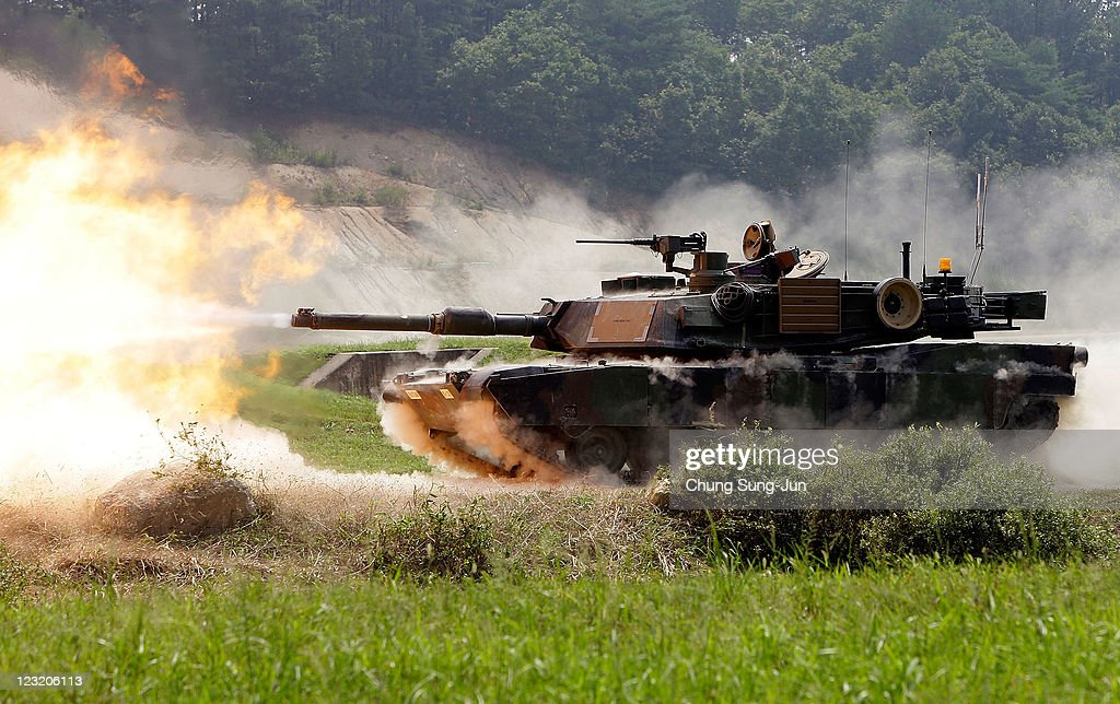 Abrams battle tank fires live rounds during the United States and South Korean Joint live fire Exercise at Rodriguez Range on September 1 2011 in...