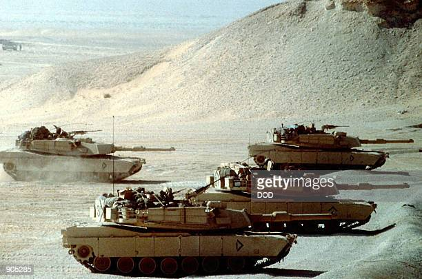 Abrams main battle tanks test their guns prior to taking part in an exercise during Operation Desert Shield