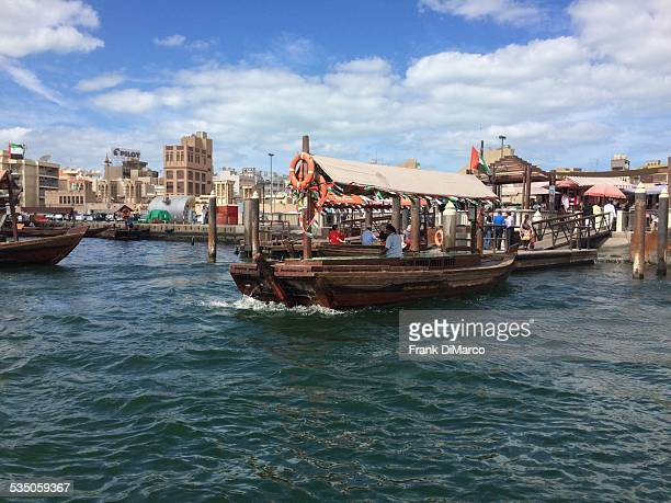 Abras water taxis along the quay on Dubai Creek United Arab Emirates
