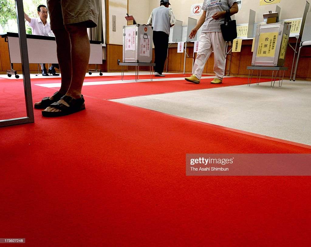 Absentee voters cast ballots by walking the 50-meter-long red carpet at an absentee vote center set at Kamisu Chuo Library on July 6, 2013 in Kamisu, Ibaraki, Japan. The local election council rolled out the red carpet at four out of sic absentee vote centers to improve voting rate, which was lower than avarage among Ibaraki Prefecture local governments. The upper house election will be held on July 21.