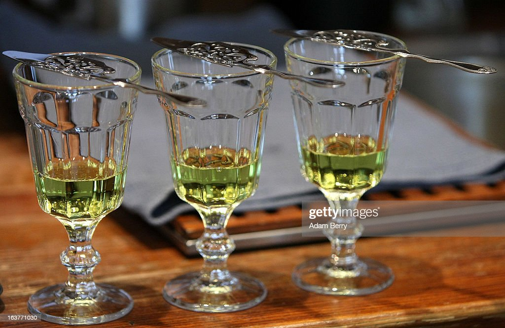Absinthe spoons lie atop glasses of absinthe at the Absinth Depot shop on March 15 2013 in Berlin Germany The highly alcoholic drink absinthe was...