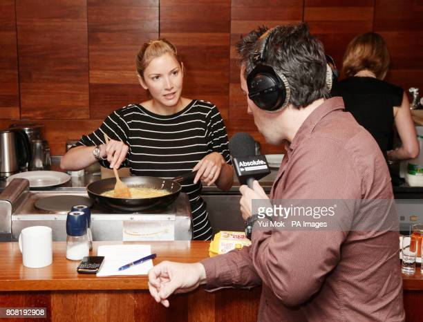 Absolute Radio presenter Christian O'Connell samples a breakfast of scrambled eggs and a Bloody Mary cooked by guest Lisa Faulkner the winner of...