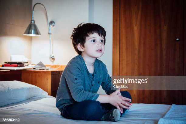 Absorbed little boy watching TV
