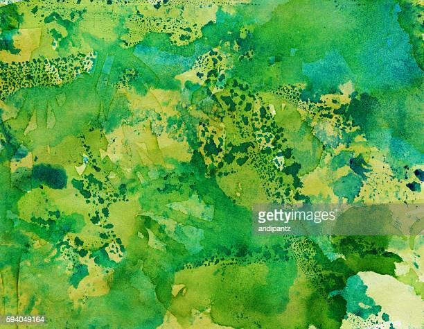 Abstract artistic background with shades of hand painted green colors