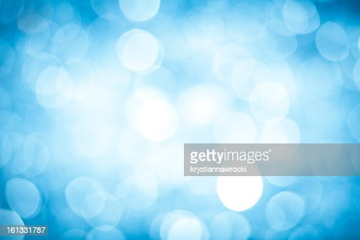 Abstract background with blurred blue sparkles