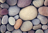 abstract background with dry round pebble stones macro