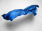 abstract piece of blue fabric flying, high-speed studio shot