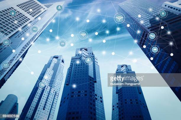 Abstract blue tone city town connected dots on bright blue background. Technology concept design