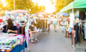 abstract blur background of people shopping at market fair, made with color filters