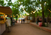 Beautiful bokeh background of the festival in the green city park.