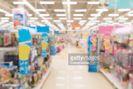 Abstract blur supermarket discount store aisle and product shelves interior defocused background : Stock Photo