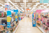 Abstract blur empty supermarket discount store aisle and product shelves interior defocused background