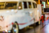 Abstract blurred background with bokeh - luxury vintage car exhibition on a shopping mall in Lithuania.