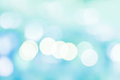 abstract blurred blue and teal colorful background with bokeh light for merry christmas and happy new year design element concept