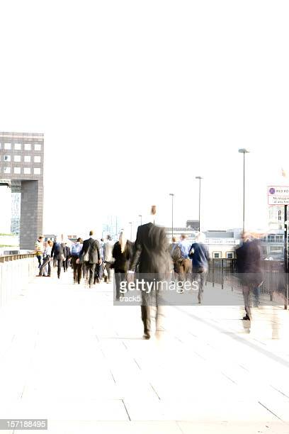 Abstract, blurred City workers rushing across London Bridge
