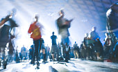 Abstract blurred people moving on and dancing at music night festival event - Defocused image of disco club party with laser show - Nightlife entertainment concept - Azure contrast spotlight filter
