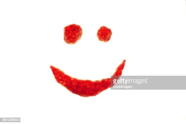 Abstract, blurred red happy face