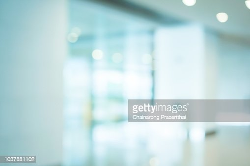 abstract blurred workplace interior with modern glass window reflective background ; loft style contemporary design of lounge or lobby for presentation and design as banner and ads : Foto stock