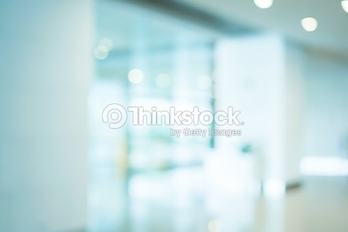abstract blurred workplace interior with modern glass window reflective background ; loft style contemporary design of lounge or lobby for presentation and design as banner and ads : Stock Photo