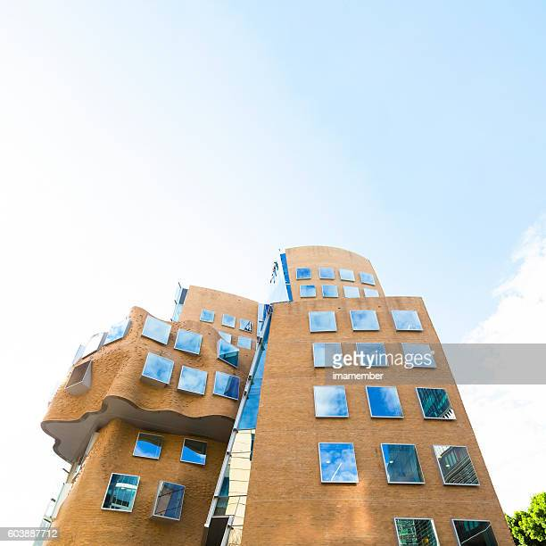 Abstract brick building with sky reflection on window, copy space