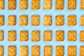 Abstract composition with crackers on blue striped background.