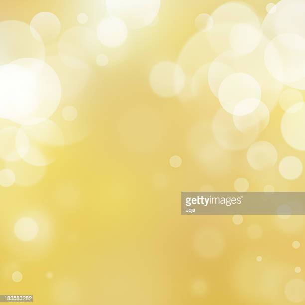 Abstract design with golden background and white bubbles