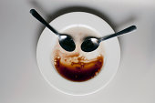 Abstract face made from spoons, plate and balsamic vinegar