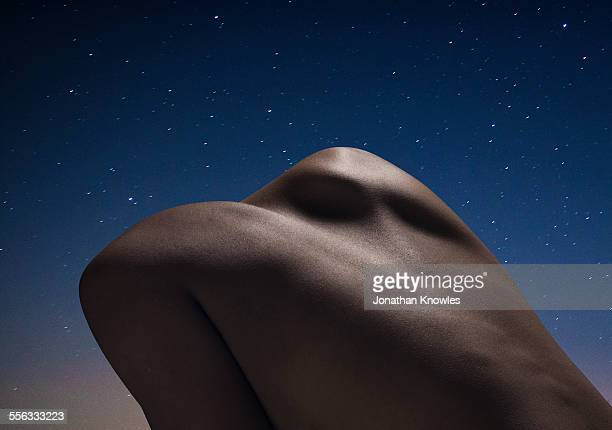Abstract female back at night