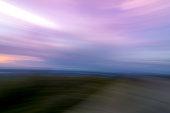 Abstract Fog lifts from the Kittatinny Mountains at sunset - slow shutter motion blur