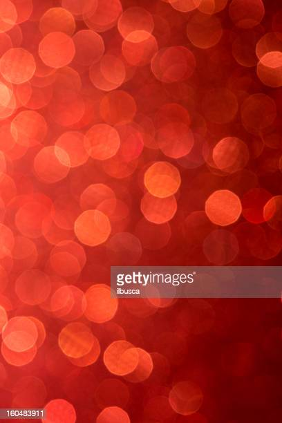 Abstract glittering paper christmas light red defocussed background