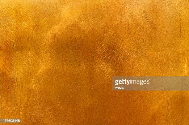 Abstract golden brass plate mottled texture for backgrounds
