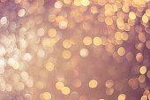 Abstract golden light bokeh light background in vintage tone.