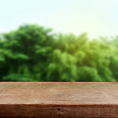 Abstract green background and wooden table.