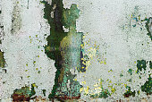 Abstract green grunge texture. Peeling paint background.
