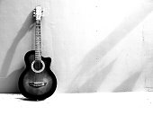 Abstract guitar on black and white color shape.