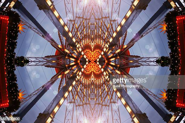 Abstract image: kaleidoscopic image of Ferris Wheel at the Christmas Market at Rotes Rathaus in Berlin