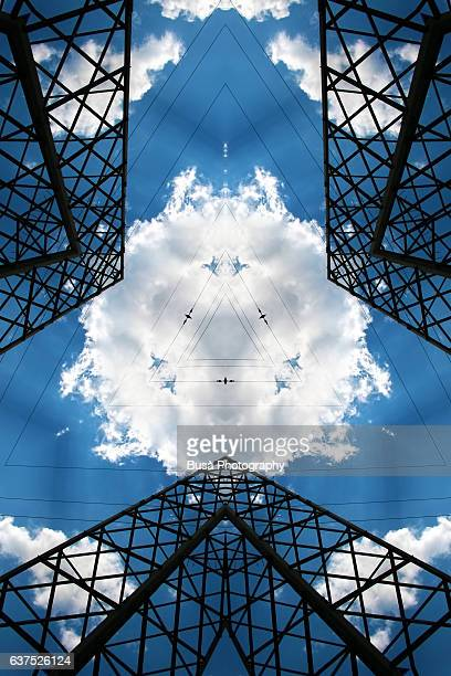 Abstract image: kaleidoscopic image of gigantic steel structures against the blue sky