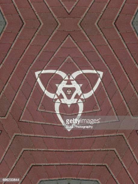 Abstract image: kaleidoscopic image of street tiles with road markings