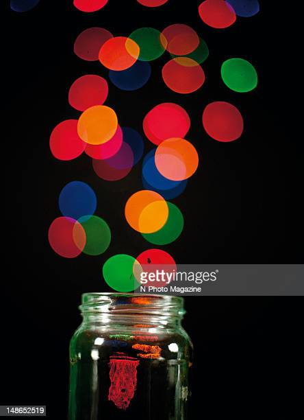 Abstract image of coloured lights streaming from an open glass jar taken on October 12 2011